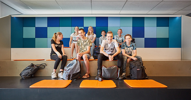 Students enjoying the custom-made tiered seating platform (by Lande).