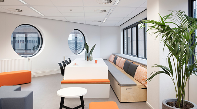 The interior of the Chargepoint office is dominated by the company colors, white, orange and gray.